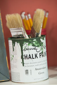 Paint can with paint brushes